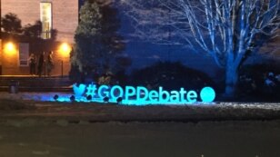 A sign outside the Republican presidential primary debate at St. Anselm College in Manchester, N.H., Feb. 6, 2016. (K. Gypson/VOA)