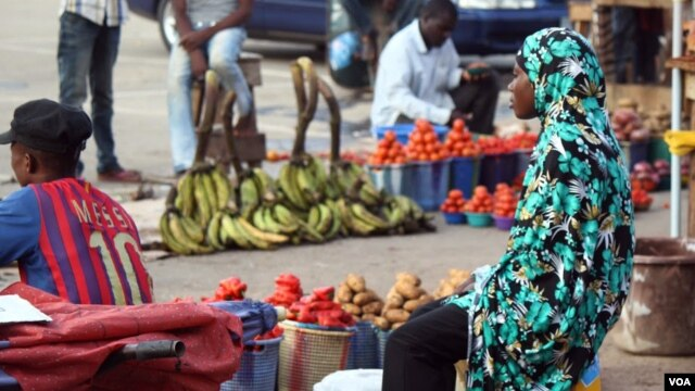 Sellers at Abuja's Utako market say they charge more for products during Ramadan because farmers charge more, Nigeria, July 2013 (Heather Murdock for VOA).