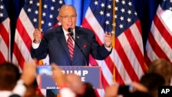 FILE - Former New York Mayor Rudy Giuliani speaks before Republican Presidential candidate Donald Trump in Youngstown, Ohio, Aug. 15, 2016.