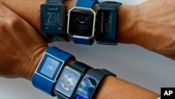Clockwise, from top left are the: Garmin Vivoactive, Fitbit Blaze, Garmin Vivoactive HR, Samsung Gear Fit2, Apple Watch and Fitbit Surge. A recent study from the Stanford University School of Medicine says fitness trackers are not accurate at tracking calories. (AP Photo/Bebeto Matthews)