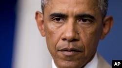 Si l'on ne fait pas le nécessaire maintenant, l'épidémie pourrait se répandre à travers l'Afrique et le reste du monde, a averti Barack Obama (AP)