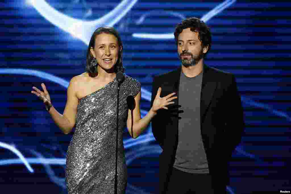 Breakthrough Prize Founders Anne Wojcicki, left, and Sergey Brin speak on stage during the second annual Breakthrough Prize Awards in Mountain View, California, Nov. 9, 2014.