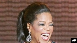 "In this May 17, 2011 photo, Oprah Winfrey acknowledges fans during a star-studded double-taping of ""Surprise Oprah! A Farewell Spectacular,"" in Chicago"