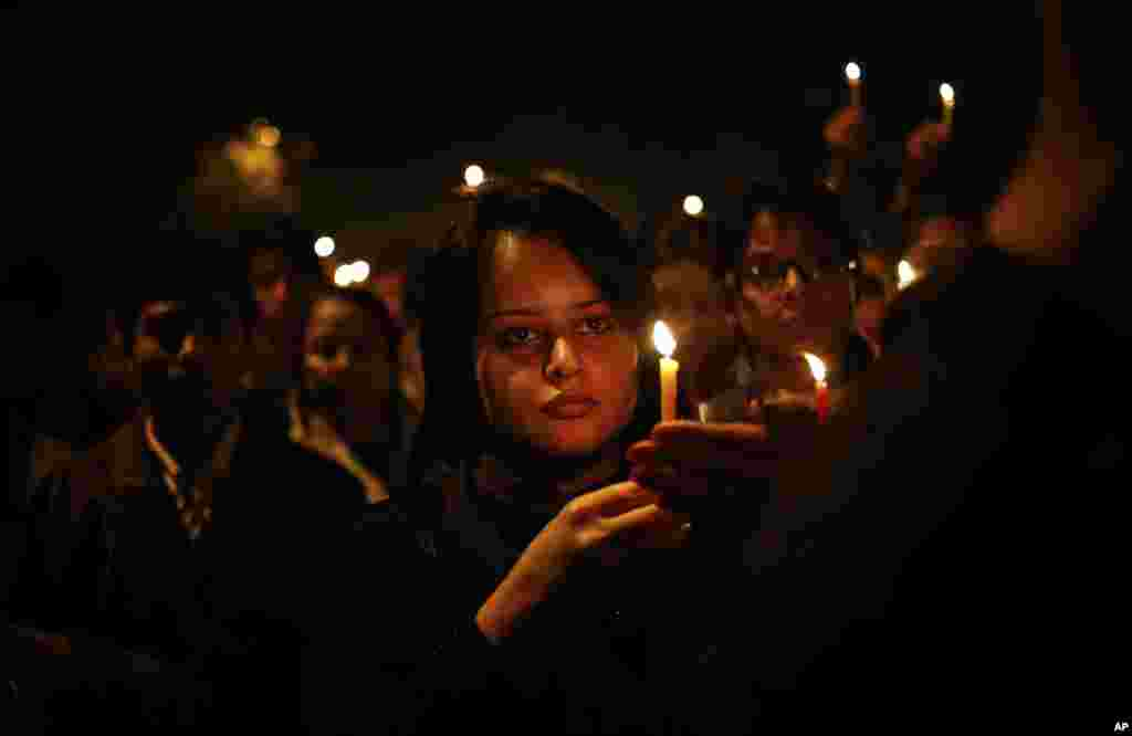 Indian women participate in a candle-lit vigil in New Delhi to mourn the death of a gang rape victim, Saturday, Dec. 29, 2012.