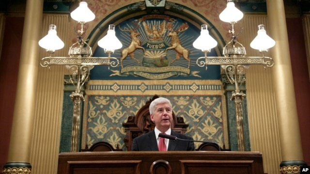 Michigan Gov. Rick Snyder delivers his State of the State address to a joint session of the House and Senate, at the state Capitol in Lansing, Mich., Jan. 19, 2016.