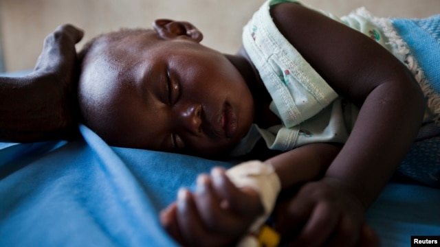 FILE - A young girl with malaria rests in the inpatient ward of the Malualkon Primary Health Care Center in Malualkon, in the South Sudanese state of Northern Bahr el Ghazal, June 1, 2012