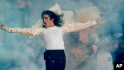 FILE - Michael Jackson performs during the halftime show at the Super Bowl XXVII in Pasadena, California, Jan. 31, 1993.