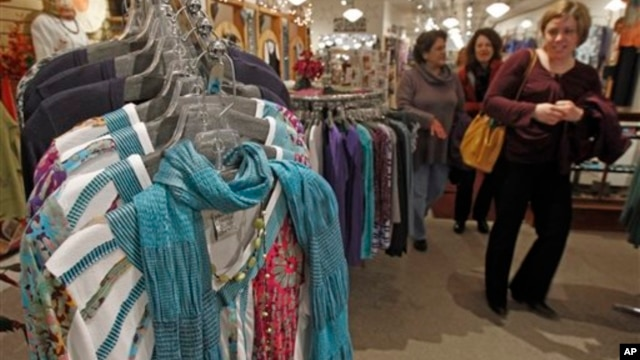 Shoppers look over the clothes at the Vermont Trading Company in Montpelier, Vermont, April 2013.