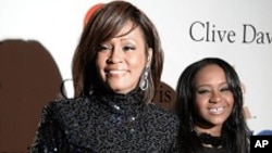 FILE - Whitney Houston and daughter Bobbi Kristina in Beverly Hills, California.