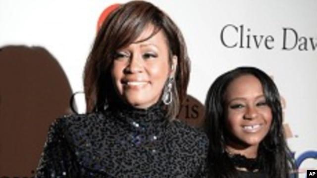 FILE - Whitney Houston and daughter Bobbi Kristina in Beverly Hills, California.