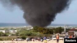 Dark smoke rises above Aden Abdule International Airport in Somalia's capital Mogadishu, Aug. 9, 2013.