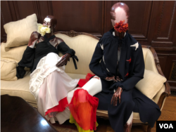 Two outfits from Azede Jean-Pierre's collection on display at the Haitian Embassy in Washington D.C. during a fashion event, Feb. 23, 2018. (VOA / S. Lemaire)