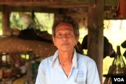 Mey Chham, 69, a resident of Sovong village in Taches commune, was uncomfortable telling his village chief he did not want to join the CPP when she came to his house and asked for photographs of each of his family members to register them in a CPP family book. (Sun Narin/VOA Khmer)