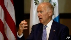 U.S. Vice President Joe Biden, right, speaks during a meeting with Guatemala's president-elect Jimmy Morales in Guatemala City, Jan 14, 2016.