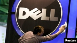 A man wipes a Dell logo at an IT exhibition in Hannover, Germany, in this February 28, 2010, file photo.