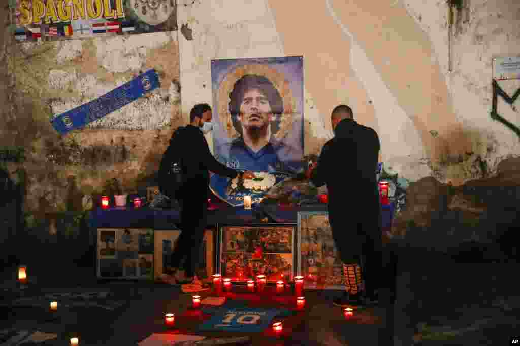 "People gather and light candles to honor soccer legend Diego Maradona, at the popular ""Quartieri Spagnoli"" neighborhood, in Naples, Italy."