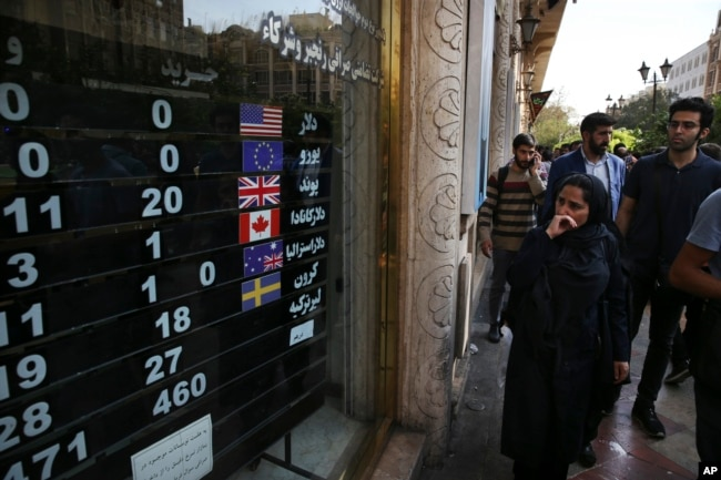 FILE - an exchange shop displays rates for various currencies, in downtown Tehran, Iran, Oct. 2, 2018.