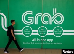 A man walks past a Grab office in Singapore, March 26, 2018.