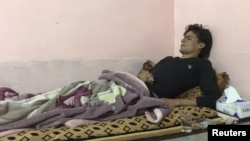 Thiaa, a 20-year-old Sunni Turkman who says he was imprisoned and beaten by the Iran-backed Shi'ite paramilitaries, is seen in Tuz Khurmato, Iraq October 27, 2017.