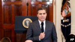 CNN journalist Jim Acosta does a standup before a new conference with President Donald Trump in the East Room of the White House in Washington, Nov. 7, 2018.