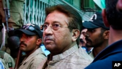FILE - In this Saturday, April 20, 2013 file photo, Pakistan's former President and military ruler Pervez Musharraf arrives at an anti-terrorism court in Islamabad. Pakistan's Supreme Court has lifted a travel ban imposed on Musharraf.