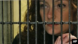 "In a undated photo, French national Florence Cassez listens to her lawyer in prison in Mexico City. The Court will propose her ""immediate and absolute"" release, March 7, 2012."
