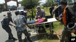 Unidentified survivor of a plane crash is carried for treatment to a nearby city of Pokhara, Nepal. The plane crashed into a mountain in the Himalayas while trying to land at an airport in northern Nepa killing 15 people and critically injuring six.