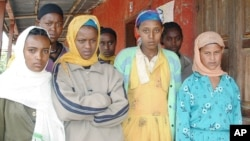 FILE - Teenage girls who have all been victims of abduction for marriage are seen, Sept. 8, 2004, in Arsi, eastern Ethiopia.
