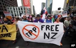 FILE - Protesters march to the venue of the Trans-Pacific Partnership signing in Auckland, New Zealand, Feb 4, 2016.