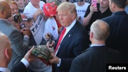 US Republican presidential candidate Donald Trump greets supporters at his campaign rally at Werner Enterprises Hangar in Omaha, Nebraska, May 6, 2016.