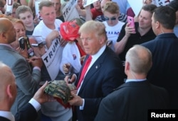 FILE - Republican presidential candidate Donald Trump greets supporters at a rally in Omaha, Nebraska on May 6, 2016.