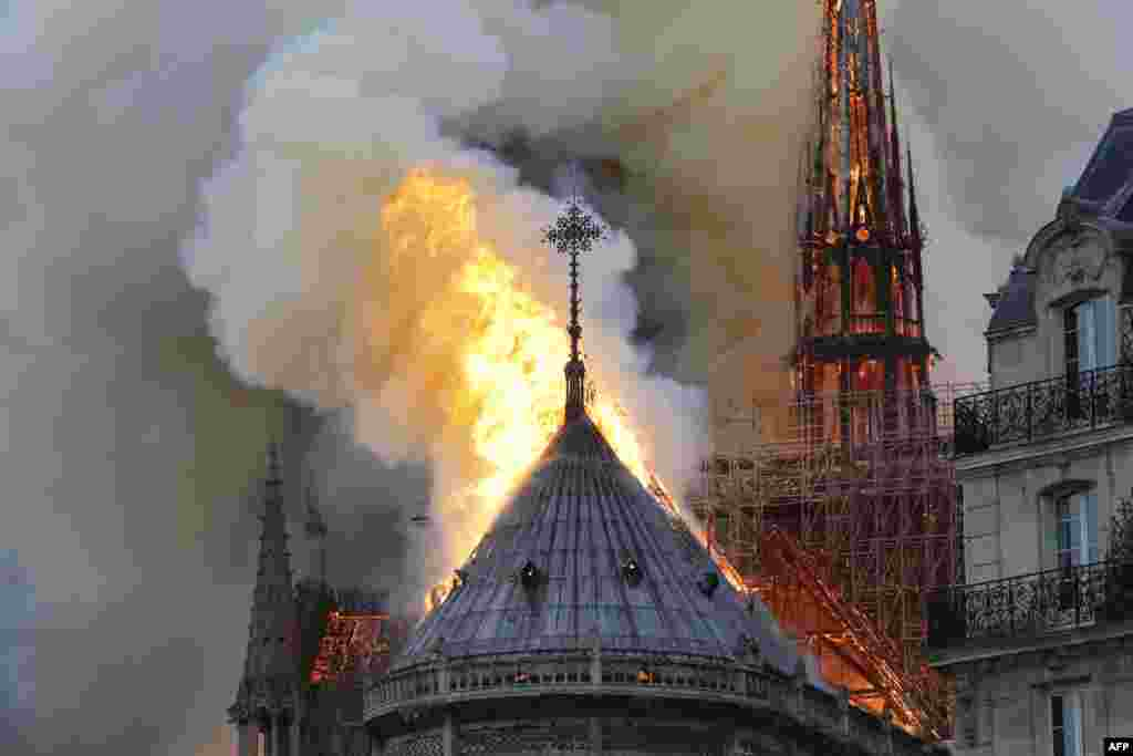 Flames burn the roof of the Notre-Dame Cathedral in Paris, France, where repairs were underway.
