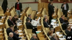 FILE - Russian lawmakers attend a session of the lower house of parliament, the State Duma in Moscow, Russia.