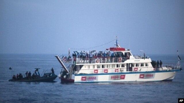FILE - Israeli soldiers raid a ship as the navy intercepts a Gaza-bound aid flotilla in the Mediterranean Sea on May 31, 2010.