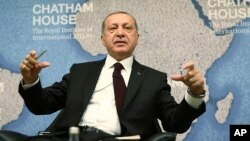 "Turkey's President Recep Tayyip Erdogan speaks at Chatham House in London, May 14, 2018. Erdogan started Sunday a three-day visit to Britain by praising the country as ""an ally and a strategic partner, but also a real friend."""