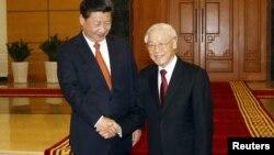 11月5日,中国国家主席习近平与越南共产党总书记阮富仲在越南河内会晤。