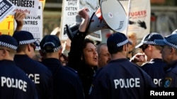 A man shouts slogans against the Australian Labor Party (ALP) during a rally in support of asylum seekers outside an ALP meeting in Sydney, July 22, 2013.