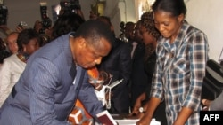 Congolese President Denis Sassou Nguessou arrives to cast his ballot in Brazzaville, Oct. 25, 2015.