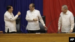 Philippine President Benigno Aquino III, center, is given a thumbs-up sign by Senate President Juan Ponce Enrile, left, while House Speaker Feliciano Belmonte looks on, after he delivers his third State of the Nation address Monday July 23, 2012.