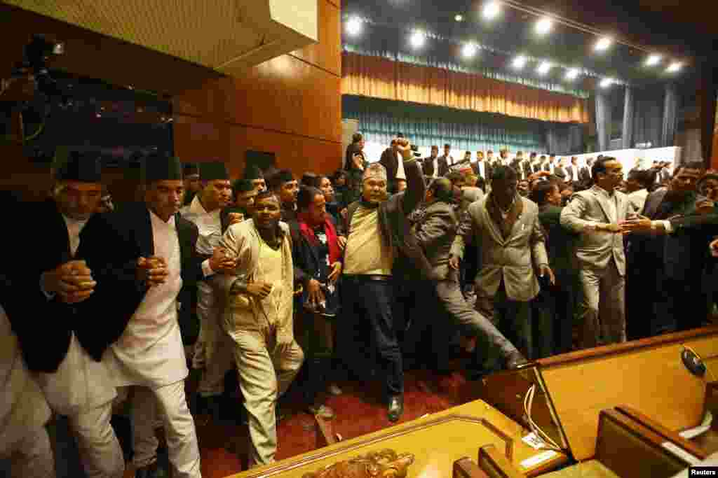 Constitution assembly members shout slogans during a meeting at the parliament on the final day to draft the new constitution in Kathmandu, Nepal.