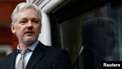 FILE - WikiLeaks founder Julian Assange makes a speech from the balcony of the Ecuadorian Embassy, in central London, Britain.