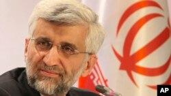 Sekretaris Dewan Keamanan Nasional Tertinggi di Iran dan kepala perunding utama program nuklir Saeed Jalili dalam jumpa pers di Kazakhstan. (AP/Pavel Mikheyev)