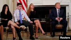 Marjory Stoneman Douglas High School shooting surviving students Jonathan Blank, 2nd from left, and Julia Cordover, as well as Jonathan's mother Melissa Blank, left, listen along with President Donald Trump during a listening session at the White House.