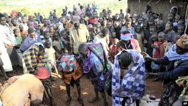 People gather around teenage girls from Uganda's Sebei tribe who have just undergone female genital mutilation in Bukwa district, about 357 kms (214 miles) northeast of Kampala (File Photo).