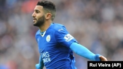Leicesters' Riyad Mahrez celebrates after scoring during he English Premier League soccer match between Leicester City and Swansea City at the King Power Stadium in Leicester, England, Sunday, April 24, 2016.