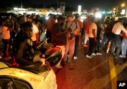 For a fifth night, protesters gather along West Florissant Avenue to protest the killing of Michael Brown a year ago, in Ferguson, Mo., Aug. 11, 2015.