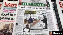 FILE - Newspapers, with details of the sentencing of James Ibori, are seen on a a news-stand in Lagos. A British court sentenced Ibori, the former governor of a Nigerian oil state, to 13 years in prison after he pleaded guilty to embezzling 50 million pounds ($79 million) in one of the biggest money-laundering cases seen in Britain.