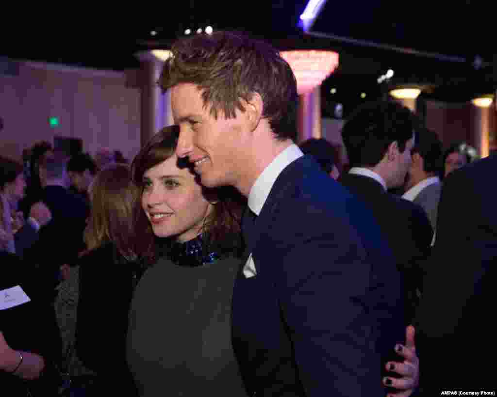 Felicity Jones (left) and Eddie Redmayne at the Oscar® Nominees Luncheon in Beverly Hills, Feb. 2, 2015.