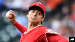 Los Angeles Angels pitcher Shohei Ohtani delivers during the first inning of the team's baseball game against the Houston Astros, Tuesday, April 24, 2018, in Houston. (AP Photo/Eric Christian Smith)