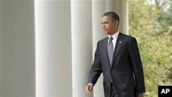 President Obama walks to the White House Rose Garden, Oct. 20, 2011 (file photo).